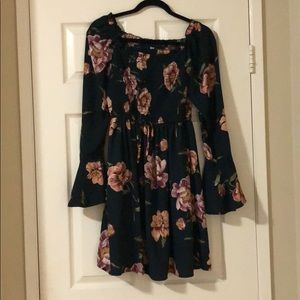 Off the shoulder green floral dress.
